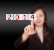 Het schermknoop met het aantal van 2014 op hand. Stock Foto