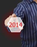 Het schermknoop met het aantal van 2014 op hand. Stock Afbeeldingen