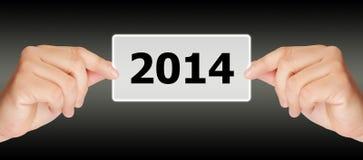 Het schermknoop met het aantal van 2014 op hand. Stock Afbeelding