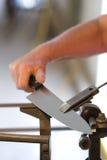 Het Scherpen van het mes Stock Afbeeldingen