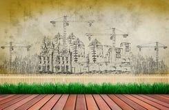 Het schetsen van bouwconstructie op lege muur met mooi park en het tuinieren vooraan stock fotografie