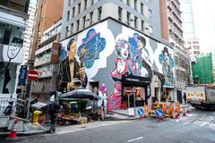 Het schilderen of de graffiti van de straatkunst op de muur bij Hollywood-weg, Hong Kong, Oriëntatiepunt en populair voor toerist royalty-vrije stock foto's