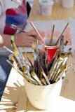 Het schilderen met borstels Royalty-vrije Stock Afbeeldingen