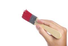 Het schilderen met rode borstel Stock Afbeelding