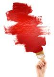 Het schilderen met rode borstel Royalty-vrije Stock Foto