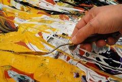 Het schilderen met spatel Stock Afbeeldingen