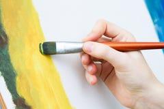Het schilderen op canvas Stock Afbeeldingen