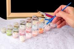 Het schilderen op canvas door aantallen Stock Foto