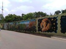 Het schilderen op muur door een lokale kunstenaar royalty-vrije stock afbeelding