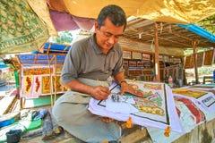 Het het schilderen proces in Bagan, Myanmar Stock Foto