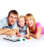 Het schilderen van de familie Stock Foto's