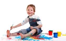 Het schilderen van de jongen stock afbeelding