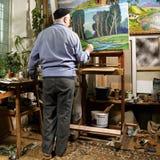 Het schilderen van de kunstenaar Stock Foto's