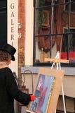 Het schilderen van de kunstenaar kunst op canvas stock fotografie