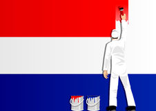 Het schilderen van de Vlag van Nederland Stock Foto