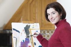 Het schilderen van de vrouw waterverf. stock afbeelding
