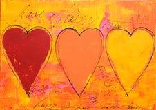 Het schilderen van drie harten Stock Afbeeldingen