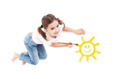 Het schilderen van een gelukkige zon Royalty-vrije Stock Foto