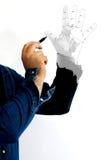 Het schilderen van een hand Stock Afbeeldingen