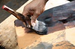 Het schilderen van een houten plak Stock Fotografie
