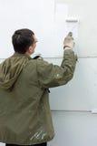 Het schilderen van een muur Royalty-vrije Stock Fotografie