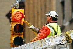 Het schilderen van een straatlantaarn Stock Foto