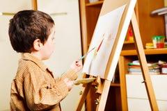 Het schilderen van het jonge geitje Stock Foto