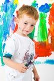 Het schilderen van het kind met een grote uitdrukking Royalty-vrije Stock Foto's