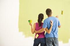 Het schilderen van het paar huis. Stock Afbeeldingen