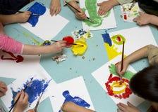 Het schilderen van kinderen Stock Foto's