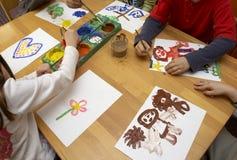 Het schilderen van kinderen Royalty-vrije Stock Afbeeldingen