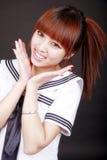 Het schoolmeisje van Azië in eenvormig Stock Afbeeldingen