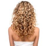 Het schoonheidsmeisje met blonde permed haar Stock Foto