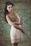 Het schoonheidsmeisje met palm doorbladert Royalty-vrije Stock Afbeelding
