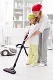 Het schoonmaken dag in de familie Stock Fotografie