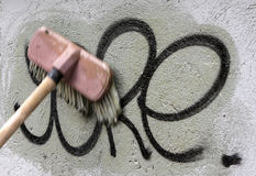 Het schoonmaken graffiti royalty-vrije stock afbeeldingen