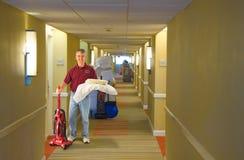 Het schoonmaken het personeel van het bemanningshotel het werken Stock Afbeelding