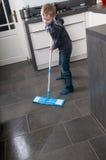 Het schoonmaken van de vloer Stock Foto