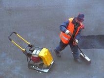 Het schoonmaken van de weg Stock Foto's