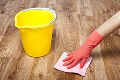 Het schoonmaken van het parket Stock Afbeelding