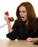 Het schreeuwen in de telefoon Stock Foto