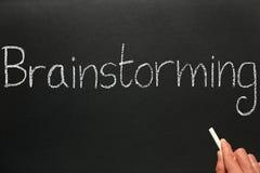 Het schrijven brainstorming op een bord. Stock Fotografie