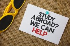 Het schrijven de nota die Studie tonen vraagt in het buitenland wij kan helpen Bedrijfsfoto demonstratie volledig gaan overzee uw royalty-vrije stock afbeelding