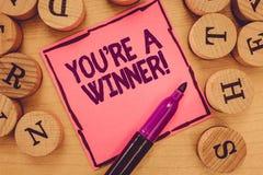 Het schrijven de nota die u tonen aangaande is een Winnaar Bedrijfsfoto demonstratie het Winnen als 1st plaats of kampioen in a stock fotografie
