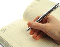Het schrijven in een notitieboekje Royalty-vrije Stock Foto