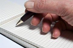Het schrijven met een ballpoint Stock Foto