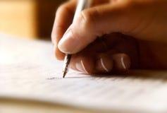 Het schrijven met een pen stock fotografie
