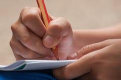 Het schrijven met potlood royalty-vrije stock afbeeldingen