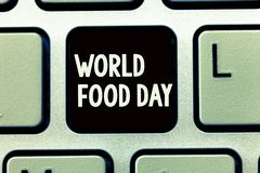 Het schrijven nota die de Dag van het Wereldvoedsel tonen De dag van de bedrijfsfoto demonstratiewereld van actie gewijd aan het  stock foto