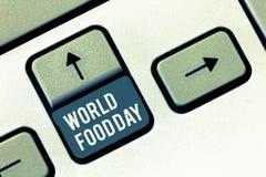 Het schrijven nota die de Dag van het Wereldvoedsel tonen De dag van de bedrijfsfoto demonstratiewereld van actie gewijd aan het  royalty-vrije stock afbeeldingen